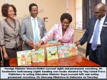 MINISTER VENSON-MOITOI HANDS OVER BOOKS